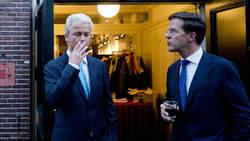 Mark Rutte looking at GeertvWilders smoking
